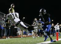 Plano East wide receiver Cameron Moore (14) is unable to make a catch during a double reverse play to the end zone on a fourth down and 17 in the second quarter during a high school football game between Plano East and Hebron at Hawk Stadium in Carrollton, Texas Thursday October 29, 2015. (Andy Jacobsohn/The Dallas Morning News)(The Dallas Morning News)
