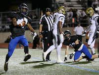 Hebron running back Derian Vaughn (28) celebrates after rushing for a touchdown to make the score 6-7 in the second quarter during a high school football game between Plano East and Hebron at Hawk Stadium in Carrollton, Texas Thursday October 29, 2015. (Andy Jacobsohn/The Dallas Morning News)(The Dallas Morning News)