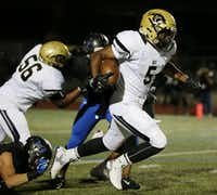 Plano East running back Trey Hunter (5) rushes 94 yards to score a touchdown to make the score 13-7 in the second quarter during a high school football game between Plano East and Hebron at Hawk Stadium in Carrollton, Texas Thursday October 29, 2015. (Andy Jacobsohn/The Dallas Morning News)(The Dallas Morning News)