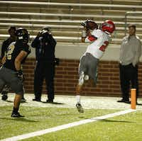 Cedar Hill  Malik Orr catches a touchdown pass in front of Mansfield's Corbin Frederick runs the during their game at Vernon Newsom Stadium  in Mansfield, Texas October 29, 2015. Mansfield won the game 46-43 (Nathan Hunsinger The Dallas Morning News)(The Dallas Morning News)