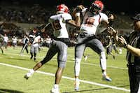 Cedar Hill's Camron Buckley (13) and Avery Davis celebrate after Buckley touchdown in the third quarter against Mansfield during their game at Vernon Newsom Stadium  in Mansfield, Texas October 29, 2015. Mansfield won the game 46-43 (Nathan Hunsinger The Dallas Morning News)(The Dallas Morning News)