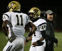 Plano East head coach Joey McCullough speaks to his players during a high school football game between Plano East and Hebron at Hawk Stadium in Carrollton, Texas Thursday October 29, 2015. Plano East beat Hebron 21-14. (Andy Jacobsohn/The Dallas Morning News)(The Dallas Morning News)
