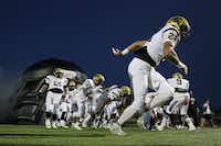 Plano East players run onto the field before a high school football game between Plano East and Hebron at Hawk Stadium in Carrollton, Texas Thursday October 29, 2015. (Andy Jacobsohn/The Dallas Morning News)(The Dallas Morning News)