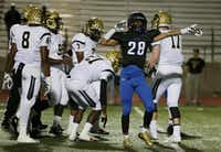 Hebron running back Derian Vaughn (28) celebrates after rushing for a first down in the first quarter during a high school football game between Plano East and Hebron at Hawk Stadium in Carrollton, Texas Thursday October 29, 2015. (Andy Jacobsohn/The Dallas Morning News)(The Dallas Morning News)