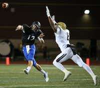 Hebron quarterback Clayton Tune (12) throws the ball while being covered by Plano East defensive back Reuben Donald (8) in the first quarter during a high school football game between Plano East and Hebron at Hawk Stadium in Carrollton, Texas Thursday October 29, 2015. (Andy Jacobsohn/The Dallas Morning News)(The Dallas Morning News)