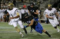 Plano East quarterback Miklo Smalls (1) maneuvers with the ball while being covered by Hebron inside linebacker Chris Braman (18) on a third down and 9 yards to go in the first quarter during a high school football game between Plano East and Hebron at Hawk Stadium in Carrollton, Texas Thursday October 29, 2015. (Andy Jacobsohn/The Dallas Morning News)(The Dallas Morning News)