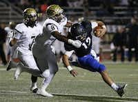 Hebron quarterback Clayton Tune (12) is sacked by Plano East defensive back Reuben Donald (8) following the mishandling of the snap on a fourth down and 2 yards to go in the second quarter during a high school football game between Plano East and Hebron at Hawk Stadium in Carrollton, Texas Thursday October 29, 2015. (Andy Jacobsohn/The Dallas Morning News)(The Dallas Morning News)