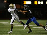Plano East wide receiver Cameron Moore catches the ball on a third down and 18 yards to go but is unable to get the first down while being covered by Hebron outside linebacker Jacob Thimesch (22) in the fourth quarter during a high school football game between Plano East and Hebron at Hawk Stadium in Carrollton, Texas Thursday October 29, 2015. Plano East beat Hebron 21-14. (Andy Jacobsohn/The Dallas Morning News)(The Dallas Morning News)