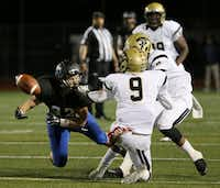 Hebron receiver Mark Scott (32) is unable to make a reception on a reverse play while being covered by Plano East defensive backs Quan Beasley (7), back, and Jordan Williams (9) in the fourth quarter during a high school football game between Plano East and Hebron at Hawk Stadium in Carrollton, Texas Thursday October 29, 2015. Plano East beat Hebron 21-14. (Andy Jacobsohn/The Dallas Morning News)(The Dallas Morning News)