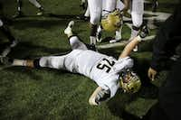Plano East offensive lineman Casey Verhulst (75) celebrates on the ground following a high school football game between Plano East and Hebron at Hawk Stadium in Carrollton, Texas Thursday October 29, 2015. Plano East beat Hebron 21-14. (Andy Jacobsohn/The Dallas Morning News)(The Dallas Morning News)