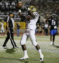 Plano East running back Desmond Bowden (28) celebrates after scoring a rushing touchdown to make the score 6-0 in the first quarter during a high school football game between Plano East and Hebron at Hawk Stadium in Carrollton, Texas Thursday October 29, 2015. (Andy Jacobsohn/The Dallas Morning News)(The Dallas Morning News)
