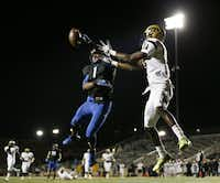 Hebron defensive back Isaiah Gary (1) breaks up a pass intended by Plano East wide receiver Audie Omotosho (11) in the second quarter during a high school football game between Plano East and Hebron at Hawk Stadium in Carrollton, Texas Thursday October 29, 2015. A holding call on the offense resulted in the first down play being replayed. (Andy Jacobsohn/The Dallas Morning News)(The Dallas Morning News)