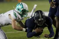 Lake Dallas Falcons Jacob Peppard (left) attempts to tackle Frisco Lone Star Rangers QB Jason Shelley as he dives in the 3rd quarter as Lake Dallas faces Frisco Lone Star at Eagle Stadium in Allen on Friday, Dec. 11, 2015. (Rachel Woolf/The Dallas Morning News)(Rachel Woolf, The Dallas Morning News)