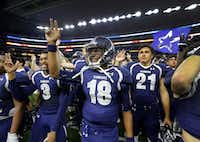 Frisco Lone Star quarterback Jason Shelley and his teammates listen to the school song following their win over Lancaster in the 5A Div II Region II Final at AT&T Stadium in Arlington, Texas, Friday, December 4, 2015. Frisco Lone Star won 49-34. (Tom Fox/The Dallas Morning News)(The Dallas Morning News)