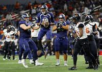 Frisco Lone Star quarterback Jason Shelley (18) reacts after a play where he almost broke away for a touchdown after nearly being sacked by Lancaster in the second quarter of the 5A Div II Region II Final at AT&T Stadium in Arlington, Texas, Friday, December 4, 2015. (Tom Fox/The Dallas Morning News)(The Dallas Morning News)