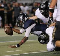 Frisco Lone Star quarterback Jason Shelley (18) is tackled after running with the ball in the third quarter during a high school football game between The Colony and Frisco Lone Star at Frisco Memorial Stadium in Frisco, Texas Thursday October 1, 2015. Frisco Lone Star beat The Colony 56-28. (Andy Jacobsohn/The Dallas Morning News)(The Dallas Morning News)