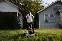 Leroy Bee mows the lawn of a house along 9th Street on the east side of Interstate 35 in the Tenth Street Historic District in Dallas Tuesday June 22, 2016. The house is owned by Bee's friend, George Nunn, who no longer lives in the neighborhood. The neighborhood is just north of the Dallas Zoo, in the Oak Cliff area of Dallas.(Andy Jacobsohn/The Dallas Morning News)