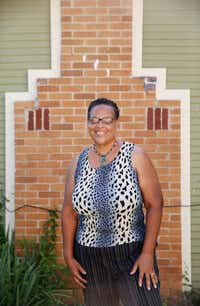 Lou Nell Sims stands for a portrait outside her house  along 11th Street on the east side of Interstate 35 in the Tenth Street Historic District in Dallas Tuesday June 22, 2016. Sims has lived in the house since the age of 6. She is the third generation in her family to reside in the historic district. Her home was built in 1930. (Andy Jacobsohn/The Dallas Morning News)