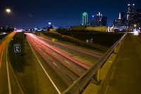 The view of Interstate 30 from the S. Harwood Street bridge on Saturday, June 18, 2016 in Dallas. The highway divides downtown Dallas from the Cedars neighborhood located south of Interstate 30.(Ashley Landis/The Dallas Morning News)