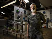 Jim Bowman, glasswork artist and owner of Bowman Glass, poses for a portrait in his studio on Tuesday, June 21, 2016 in Dallas. His studio and home are located about block south of Interstate 30 on Griffin St E. in the Cedars neighborhood, south of Interstate 30 across from downtown.(Ashley Landis/The Dallas Morning News)