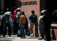 People wait in line at the welcome building inside The Bridge Homeless Recovery Center on Tuesday, June 21, 2016 on Corsicana St in downtown Dallas. (Ashley Landis/The Dallas Morning News)