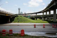 A pedestrian walks east underneath Interstate 35 along Continental Avenue, heading towards the Victory Park neighborhood in Dallas Tuesday June 22, 2016.(Andy Jacobsohn/The Dallas Morning News)
