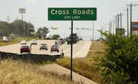 A new city limit sign has replaced the old one which once bore the under 1,000 population in the small Denton County town of Cross Roads, Texas, Wednesday, June 8, 2016.(Tom Fox/Staff Photographer)