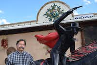 "<p>Glencoe Fruit Stand owner Monroy Montes installed&nbsp;<span style=""font-size: 1em; line-height: 1.364; background-color: transparent;"">a life-sized statue of Texas Tech's Masked Rider to appeal to his Texas customers.</span></p>(John Lumpkin/Special Contributor)"