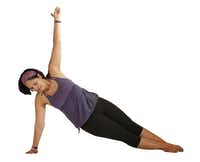 A side plank demonstrated by personal trainer Sylvia Bernal(Nathan Hunsinger/Staff Photo)
