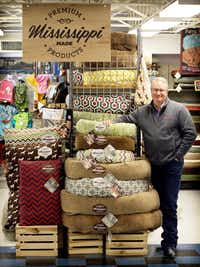 Shawn McGhee, president of Memphis-based Hollywood Feed, is photographed with pet beds made in Mississippi. About 75 percent of the store's products are made in the U.S. The pet supply chain opened 20 stores in Dallas-Fort Worth from 2014 to 2016 and plans to open 20 more over the next few years.