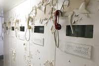 Paint peels over visitation phones in a decommissioned jail inside the old Dallas County Criminal Courts Building. The Dallas County Records Building will be demolished and renovated into county administrative offices in a $138 million project beginning in September.(David Woo/Staff Photographer)