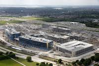 Toyota's U.S. headquarters is rising along the Sam Rayburn Tollway in Plano. With such massive growth in property and real estate value, Denton and Collin county government leaders are dropping their county property tax rate to match last year's revenues. (Vernon Bryant/The Dallas Morning News)