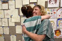 Dallas County prisoners hug during a rehabilitation program.(Staff File Photo)
