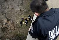 Dallas County Deputy Michael Ortiz watches a forensic team collect evidence in an area of the Trinity River near Dowdy Ferry Road in southeast Dallas, where Luis Campos and his pregnant girlfriend, Linoshka Torres, were found on Feb. 2, 2007. (FIle Photo)