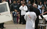 "<p><span style=""font-size: 1em; line-height: 1.364; background-color: transparent;"">Teodora Ortega de Campos (in white coat), Luis Campos' mother, grieves as the caskets are loaded into the hearses after a joint funeral for Linoshka Torres and Luis Campos at St. Francis of Assisi Catholic Church in Lancaster.</span></p>( File Photo)"