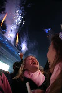 AND ON NEW YEARS EVE ... Sarah Cooper (left) and Elizabeth Cooper laugh as they watch fireworks at the Big D New Years Eve celebration in Victory Park outside the American Airlines Center in Dallas on December 31, 2012. (Nathan Hunsinger/ Staff Photographer)(Nathan Hunsinger/Staff Photographer)