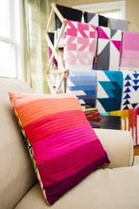 Finished quilts by Kristi Schroeder on display in the living room of her one-bedroom Park Cities apartment she uses as her workshop and studio on Wednesday, April 13, 2016, in Dallas. (Smiley N. Pool/The Dallas Morning News)The Dallas Morning News