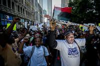 Ernest Walker led other protesters at Thursday night's rally in downtown Dallas, which was organized after the killings of Alton Sterling by police officers in Baton Rouge, La., and Philando Castile in Minnesota..(Smiley N. Pool/Staff Photographer)