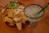 In La Plazuela restaurant at La Fonda Santa Fe, the Centenario Margarita, combining Centenario Tequila with Grand Marnier, Patron Citronge, a splash of Presidente Brandy and a healthy pour of lime and lemon juice, pairs perfectly with a delicious, buttery guacamole. (Helen Anders)