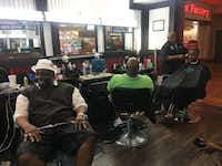 Men hang out at Trendz Barber Shop in Southwest Center Mall, discussing Thursday's protest that turned violent.(Sarah Mervosh/Staff)