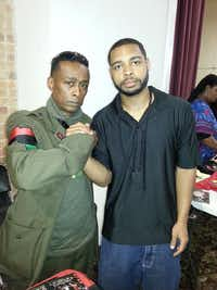 "Photo of suspect in July 8 Dallas police shooting Micah Johnson with Fahed Hassen / Professor Griff from Public Enemy. Original photo caption on Facebook reads ""Professor Griff from Public Enemy and myself"" and is dated April 30, 2016, with 11 likes."