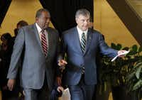 State Sen. Royce West, D-Dallas (left), and Dallas Mayor Mike Rawlings arrived at a news conference at City Hall on Friday.(Tony Gutierrez/The Associated Press)