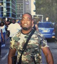 Mark Hughes carried his AR-15 rifle during Thursday night's protest.(Dallas Police Department)