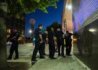 <p>Dallas police cleared the area around the Greyhound bus station downtown on Thursday night. </p>(Ashley Landis/Staff Photographer)