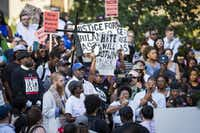 Plinks Green speaks while surrounded by protestors at a rally in downtown Dallas on Thursday. Dallas protestors rallied in the aftermath of the killing of Alton Sterling by police officers in Baton Rouge, Louisiana and Philando Castile, who was killed by police less than 48 hours in Minnesota.Smiley N. Pool./The Dallas Morning News