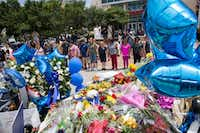 People form a prayer circle surrounding  the memorial for the slain officers at the Dallas Police Headquarters on July 9, 2016 in Dallas. (Ting Shen/The Dallas Morning News)(The Dallas Morning News)