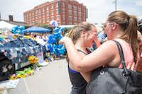 Abbey Wheeler, 14, wipes away tears as her  sister Madison Wheeler, 19, comforts her in front of the memorial for the slain officers at theDallas Police Headquarters on July 9, 2016 in Dallas. (Ting Shen/The Dallas Morning News)(The Dallas Morning News)