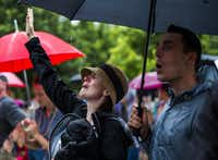"""<p><span style=""""font-size: 1em; line-height: 1.364; background-color: transparent;"""">Amberand Mark Hapka sang Saturday at a service at Klyde Warren Park in downtown Dallas. The service honored the five Dallas officers who were killed by a gunman on Thursday. (Ashley Landis/Staff Photographer)</span></p>"""