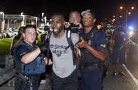 Police arrest activist DeRay Mckesson during a protest in Baton Rouge, La.(Max Becherer/The Associated Press)