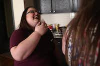 Melissa Prosser laughs with Shayla Halley at the Ebby House in Dalla. The house helps young women who have aged out of foster care.(Rose Baca/Staff Photographer)